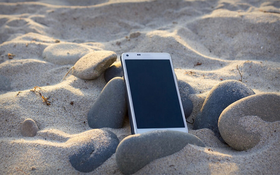 cell phone in the sand