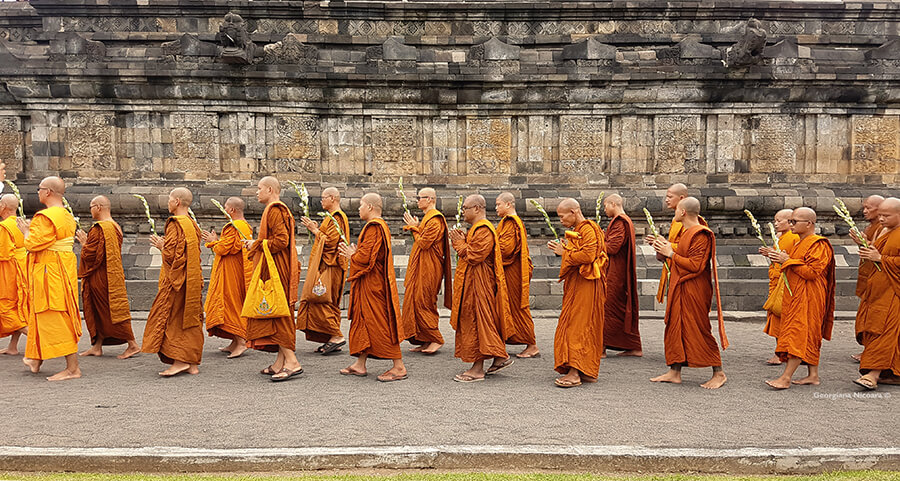 monks walking and praying